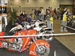 A motorcycle fan inwardly oohs and aahs over rows of - two-wheelers.