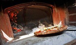 A pizza oven in Naples. - TONY'S PIZZA NAPOLETANA