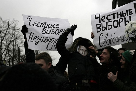 A protester dons a Navalny paper mask at a 2011 Moscow rally