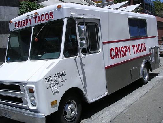 """A sign still says the truck still serves """"crazy crispy tacos."""" - JOHN BIRDSALL"""