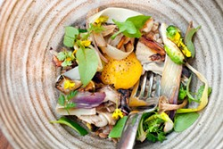 LARA HATA - A slow-cooked egg melts into the farro and root vegetables.