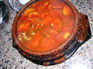 A too-healthy dose of kojuchang couldn't mask the weakness of the broth in the soon du bu. - J. BIRDSALL