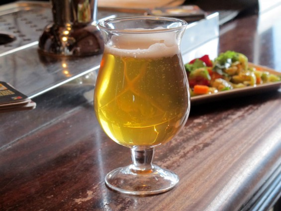 A tulip of local Fort Point Park wheat beer ($6) and Giardiniera ($6) - LOU BUSTAMANTE