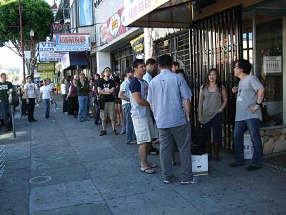 About two dozen people waited for Mission Street Food to open on Saturday night. - TAMARA PALMER