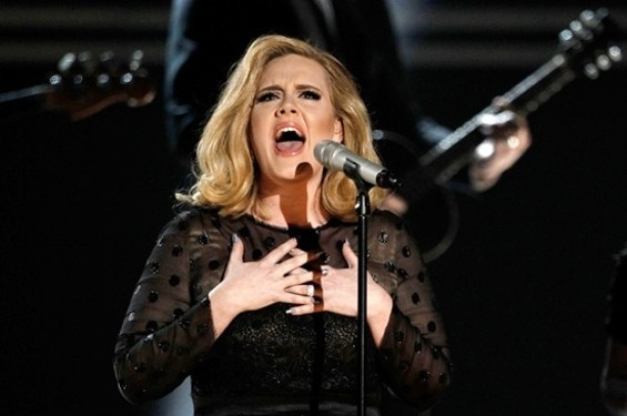 "Adele performing ""Rolling in the Deep"" at the 2012 Grammy Awards."