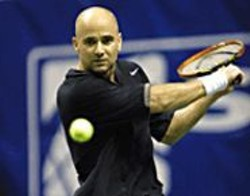RON  ANGLE - Agassi really knows how to keep his eye on - the ball.
