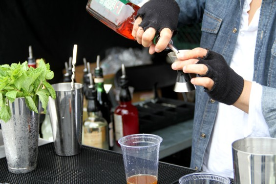 Alembic barman Danny Louie mixes up a drink at Off the Grid Fort Mason - LOU BUSTAMANTE