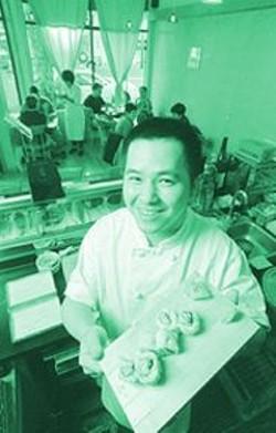 ANTHONY  PIDGEON - Amberjack Sushi chef/co-owner Raymond Ng.