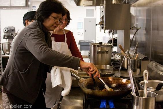 Amy Besa of Brooklyn's Purple Yam, conducting a cooking demo. - JUN BELEN