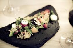 JEN SISKA - An alien garden of heirloom tomatoes, purslane, and basil sprouts on black slate.