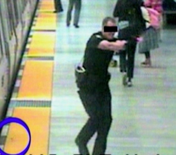 An unnamed BART police officer fires on Charles Hill