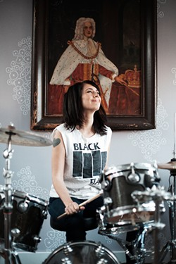 COURTESY OF ALLISON MICHAEL ORENSTEIN - .. and Kathleen Hanna, the brunette who made it okay for women to get in the mosh pit.