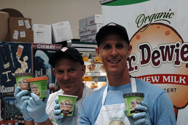 Andrew (left) and Ari Cohen proudly tote their frozen treat for health nuts. - KATHALINA URIBE