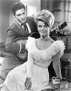 Ann-Margret plays hard  to get with the King in Viva  Las Vegas.