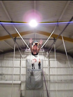 ANDREW+J.+NILSEN - Anna+Pulley+soars+through+the+air+at+Trapeze+Arts.