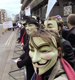 Anonymous protesters in London - JAMES HARRISON