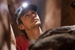 Aron Ralston (James Franco) tries to think his way out of a catastrophe.
