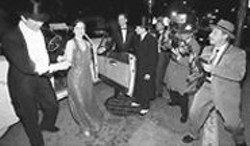 PAUL  TRAPANI - Art Decadent: Old-school paparazzi photograph guests as they arrive at the Art Deco Preservation Ball.