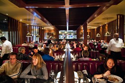 LARA HATA - As usual, the main dining room at Original Joe's is filled.