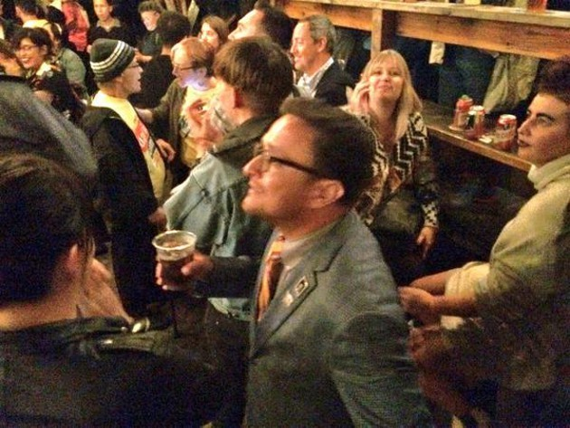 Assembly Candidate David Campos looks to the newest vote count at his election party Tuesday night. - KATE CONGER
