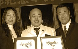 """AP PHOTO/SING TAO DAILY - Assemblywoman Fiona Ma and Sen. Leland Yee heap laurels upon Chinatown gangster Raymond """"Shrimp Boy"""" Chow. In March, Yee and Chow were arrested in a vast federal sting."""