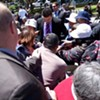 Blessing Scam Press Conference in Chinatown Ends With Ruckus Over Free Tote Bags