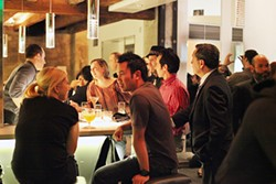 LARA HATA - At the vortex of power: Suits mingle with the unimpressed at the bar.