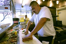 MIKE KOOZMIN - Bacon Bacon owner Jim Angelus has finally reopened his pork-centric cafe.