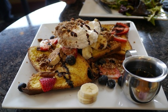 Baked French toast with fresh fruit, spiced pecans and fig reduction