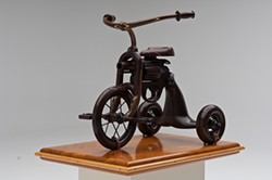 PHOTOGRAPH BY R. J. MUNA - Bay Area artist Michael Cooper's formidable tricycle isn't actually weaponized.