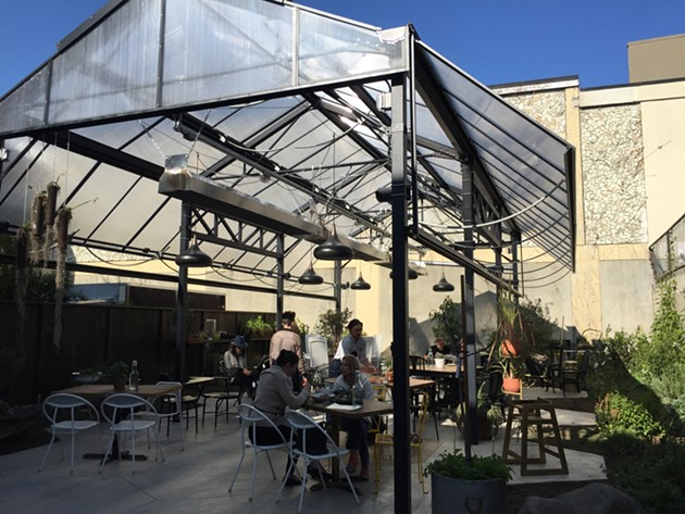 Berkeley's Mission: Heirloom Cafe has a cozy patio in back with heat lamps. - ALIX WALL