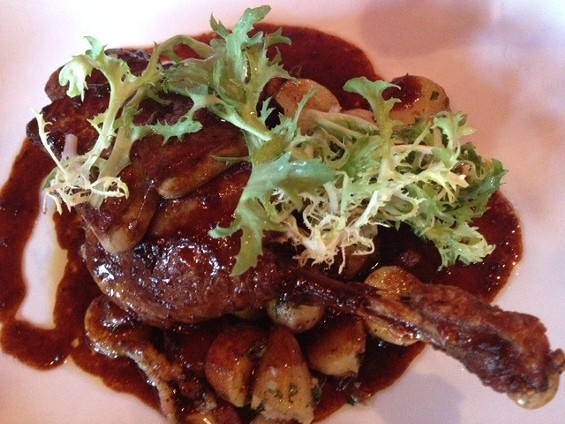 Bisou's duck leg confit topped with foie gras. - TAMARA PALMER