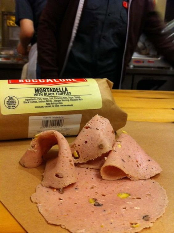 Bits of black truffle add perfume to Boccalone's holiday-issue mortadella. - LOU BUSTAMANTE