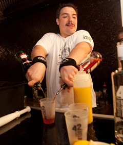 Borys Saciuk, setting a new Guinness record for cocktails made in an hour. - 42BELOW