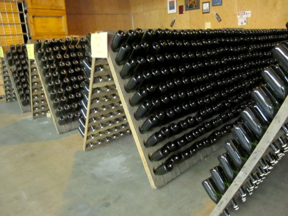Bottled on racks being riddled - LOU BUSTAMANTE
