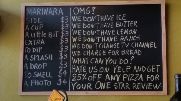 Botto Bistro now sports this sign encouraging one-star reviews for a pizza discount. - YELP/TREVOR N.