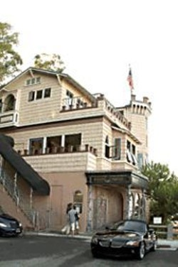 JAMES  SANDERS - Built in 1922, Julius' Castle clings to the side - of Telegraph Hill, with commanding views of - the city.