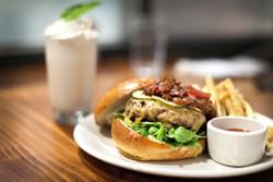 LARA HATA - Burger with grasshopper shake in the background