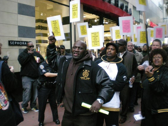 Cable car driver Eric Williams leads the assembled Muni drivers into a 'march-off' against 'March Against Muni'