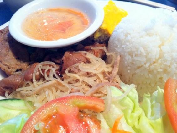 Cafe Grill Bar's rice plate with pork, egg cake, and pork skin, $7.50. - JONATHAN KAUFFMAN