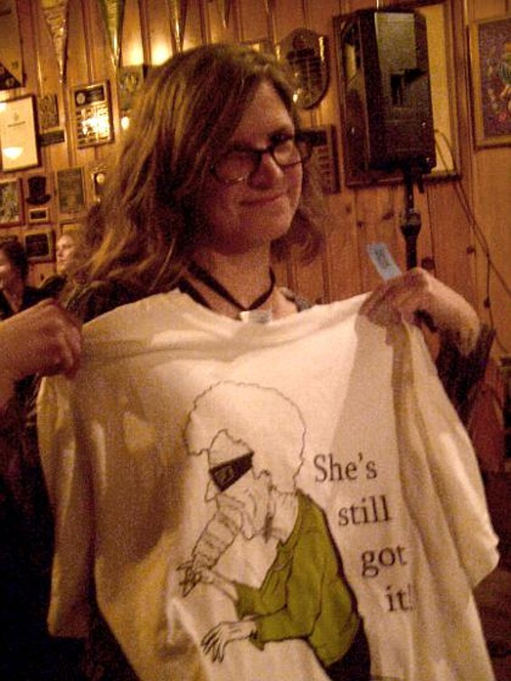 Caitlin Meyer displays a ribald T-shirt she won in a raffle.