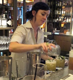 Camber Lay behind the bar at Parallel 37 - LOU BUSTAMANTE