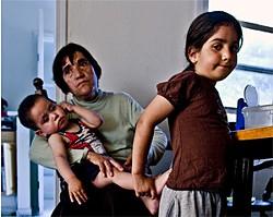 JARED GRUENWALD - Carmen Ruiz with grandchildren Gabriel and Rosemary
