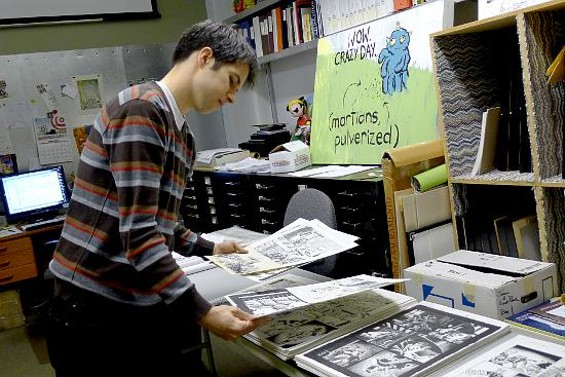 Cartoon Art Museum Curator Andrew Farago looks over the 115 pages of Severin's work.