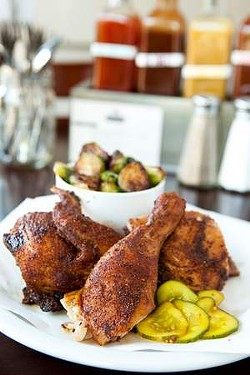 Cedar Hill's barbecued chicken, brined and smoked over white oak. - MELISSA BARNES