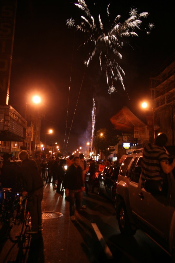 Celebratory fireworks on Mission Street. - SHANNON GALLOGLY
