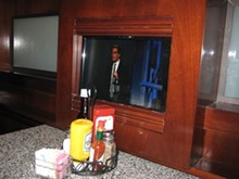 Channel surf 'n' turf: Booths come with their own TVs. - M. BRODY