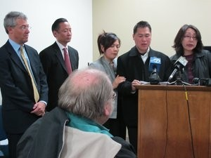 Charles Tran (at podium) alleges excessive force by SFPD at today's press conference