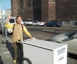 """Charlie Callahan at the wheel of the """"A La Carte"""" cart."""