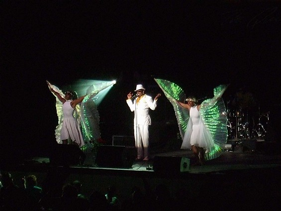 Charlie Wilson and his winged angel dancers.